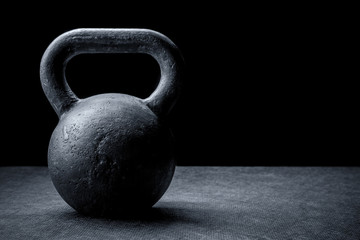 kettlebell on a black background Wall mural
