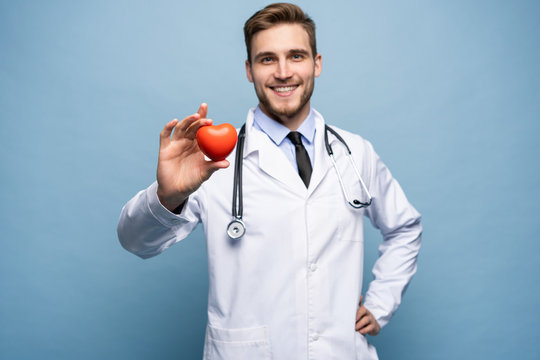 healthcare and medical concept - male doctor with heart.