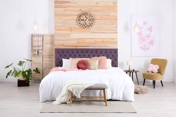 Modern interior design of cozy light bedroom