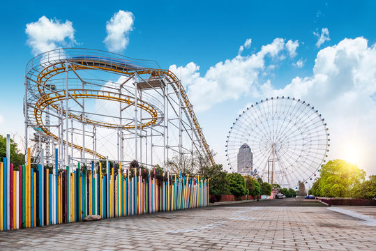 Roller coasters and ferris wheels in amusement parks。