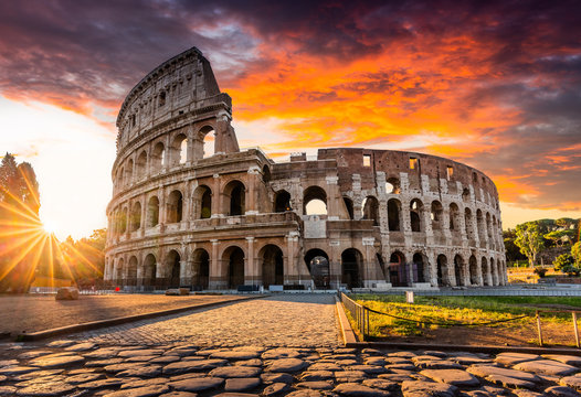Rome, Italy. The Colosseum or Coliseum at sunrise.