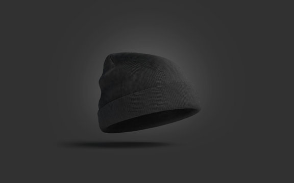 Blank black knitted beanie mockup on dark background, 3d rendering. Empty soft garment mock up. Clear wool headwear for fan or sport template.