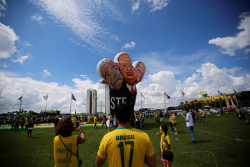 "An inflatable doll showing caricatures is pictured during a protest against corruption and in favour of the ""Car Wash"" corruption investigation, in Brasilia"