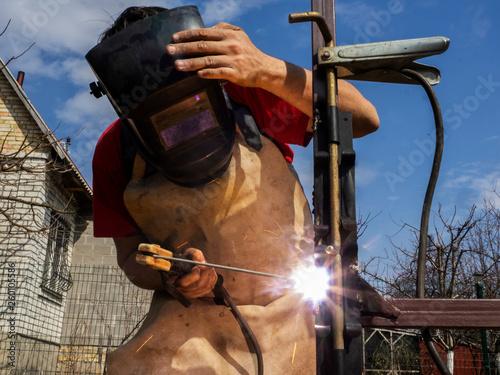 Man is welded to a steel gate metal latch