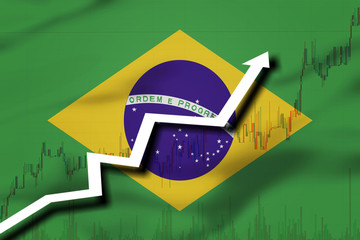 White arrow and stocks chart growth up on the background of the flag of Brazil