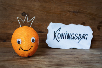 Smiling orange with a crown on his head. Holland traditional festival Koningsdag Kings day.