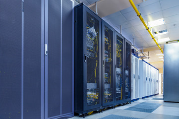 Server internet datacenter room with rows of modern mainframes. Server control center for internet provider. Network and technology concept.