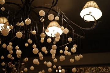 Indoor interior, beautiful modern white chandelies in the restaurant