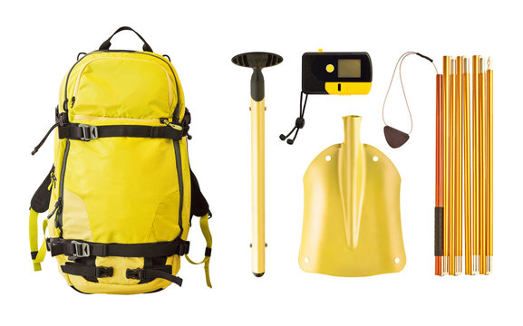 Set of avalanche equipment and gear for freeride. Backpack, shovel, probe and transceiver isolated on white background
