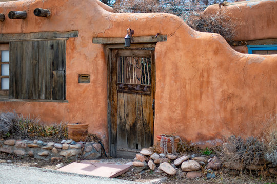 Wooden door in Adobe wall