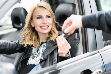 Woman taking car keys