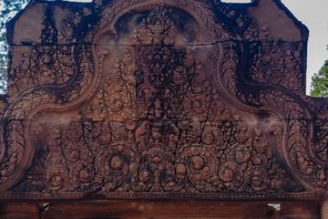 A pediment depicting mythological scenes at Banteay Srei Temple, Siem Reap, Cambodia Fototapete