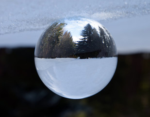 Winter mountains landscape in crystal ball.