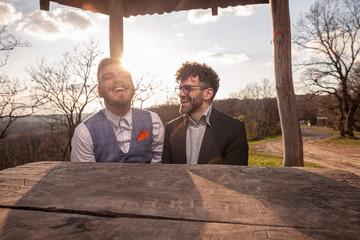 two men, gay couple portrait outdoors.