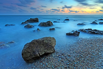 Wall Murals Turquoise Beautiful seascape with sunset on the rocky shore of a tropical beach and Island