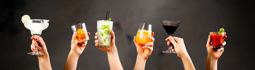 Obraz Hands holding classic cocktails on rustic background - fototapety do salonu