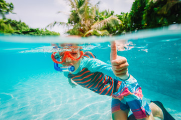 little boy enjoy swim underwater on tropical resort