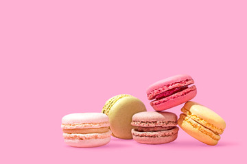 Colorful Macarons Macaroons on Bright Pink Background, Copy Space