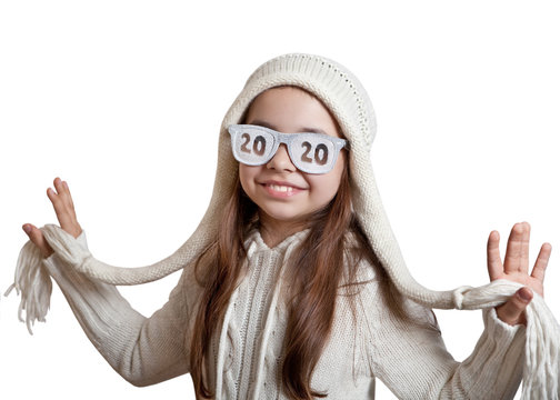 Funny girl in a knitted hat and glasses with the inscription 2020