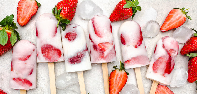 Fresh strawberry popsicles. Juicy ice cream with fruit, food for refreshing in the summer.