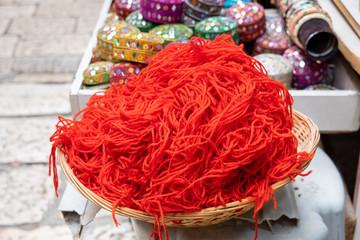 Lot of red threads or strings for sale at Jerusalem street market