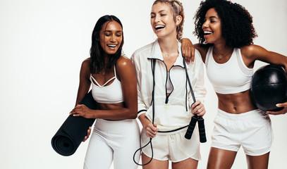 Multi-ethnic friends taking break from workout