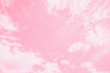 Light delicate pink sky background. Beautiful romantic sky with white clouds.Copy space, toned photo