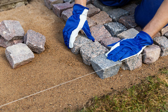 cobblestone installation - paver laying granite stone pavers