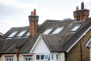 A row of British houses with roof windows
