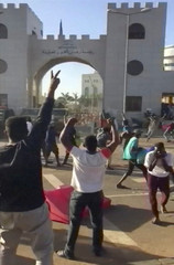 Still image taken from video showing demonstrators rally outside the defence ministry in Khartoum
