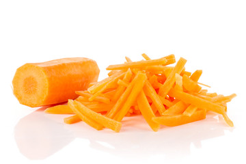 One half lot of pieces of peeled fresh orange carrot cut into thin noodles isolated on white background