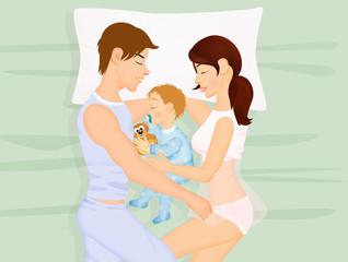family sleeps with newborn
