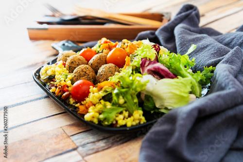 Salad with semolina, Falafels Pickled vegetables and raisins