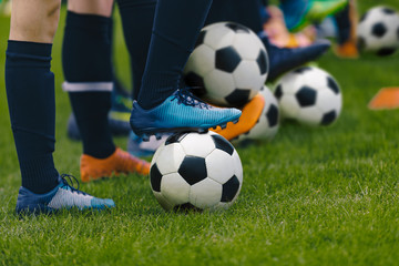Junior Football Training Session. Players Standing in a Row with Classic Black and White Balls. Youths Practice on Soccer Field. Low Angle Close-up Image of Soccer Boys. Football Education Background