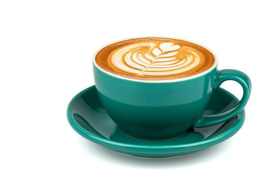 Side view of hot latte coffee with latte art in a dark green cup and saucer isolated on white background with clipping path inside.