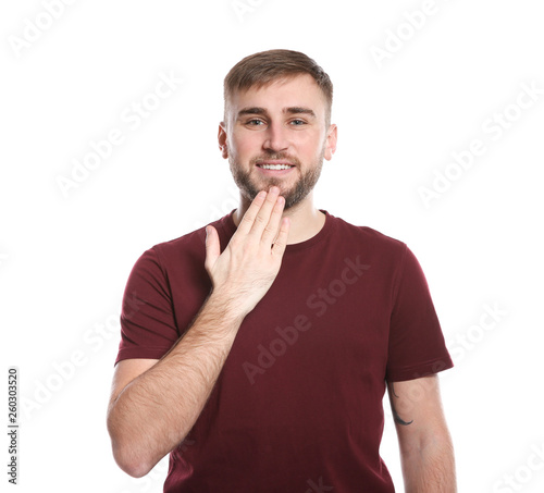 Man showing I LOVE YOU gesture in sign language on white
