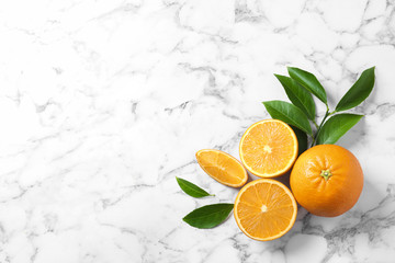 Flat lay composition with ripe oranges and space for text on marble background Wall mural