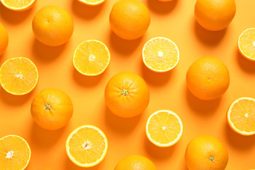 Fototapete - Flat lay composition with ripe oranges on color background