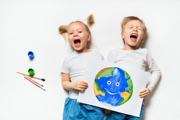 Ecology concept with two prety little kids painting earth on white background