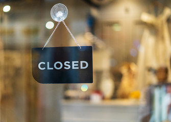 closed sign hanging outside a restaurant, store, office or other Wall mural