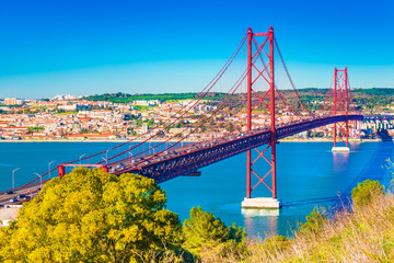The 25th April Bridge (Ponte 25 de Abril) in Lisbon, Portugal. View from Almada Fototapete