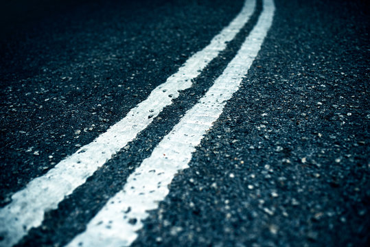 two white stripes in the middle of the road