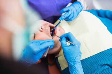 Dentists working in dental clinic
