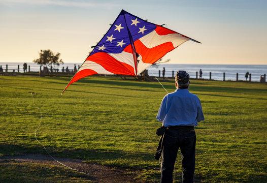 Veteran Flying an American Flag Kite