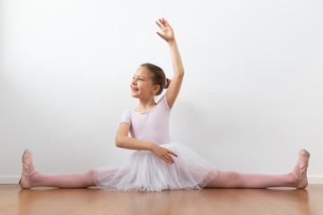 little girl dancing ballet with open legs