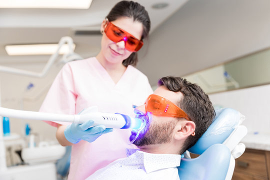 Patient Receiving Dental Treatment From Dentist
