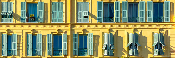 Nice in France, colorful facade, with typical murals windows and green shutters, place Garibaldi, detail