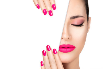 Beauty Makeup and Nail Art Concept. Beautiful fashion model woman with pink makeup. High fashion portrait isolated on white