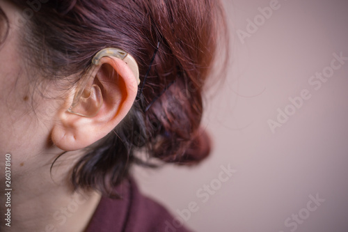 Close-up photo of a woman with hearing aid  Sensory