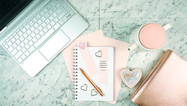 Feminine desk with modern touch screen laptop and rose gold accessories
